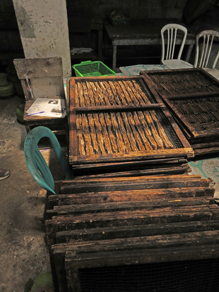 Banana chips drying on a rack in Kiniko, near Bukittinggi, Sumatra, Indonesia.