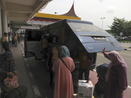 Disembarking from the AWR Travel bus at the airport in Padang, Sumatra, Indonesia.