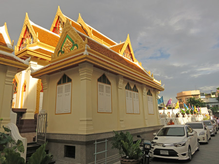Roofs aglow in the setting sun at Wat Traimit in Chinatown, Bangkok, Thailand.