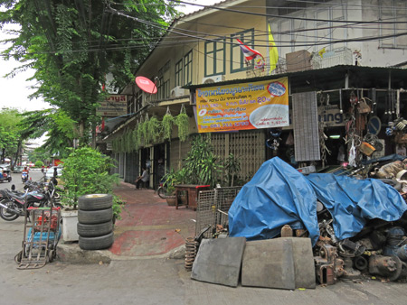 A picturesque scene on Thanon Song Wat in Chinatown, Bangkok, Thailand.