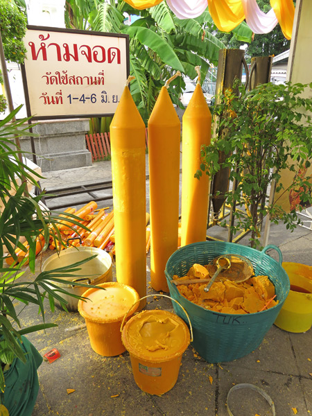 Wax and wane at Wat Traimit in Chinatown, Bangkok, Thailand.
