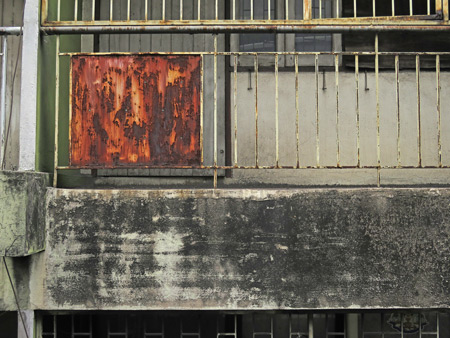A weathered wall across from the SkyTrain station at Thong Lor, Bangkok, Thailand.