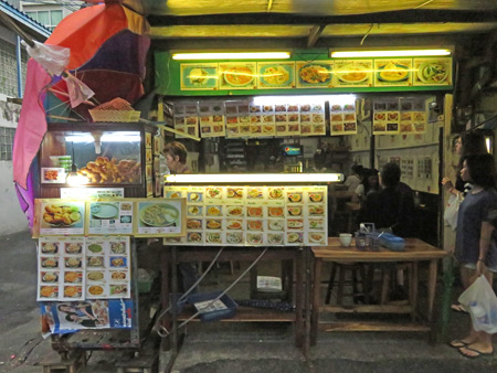 A food stall on Sukhumvit Soi 38 in Bangkok, Thailand.