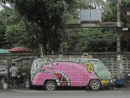A painted-up van on Soi Thong Lor in Sukhumvit, Bangkok, Thailand.
