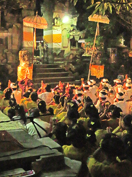 Hindu devotees prey during a temple ceremony at Pura Desa in Ubud, Bali, Indonesia.