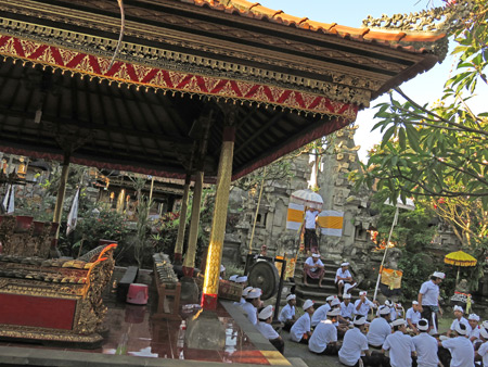A gamelan and Hindu devotees at a temple ceremony at Pura Desa in Ubud, Bali, Indonesia.