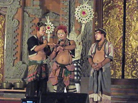 Three men perform a Bondres act at a Hindu temple ceremony at the bale banjar next door to Pura Desa in Ubud, Bali, Indonesia.