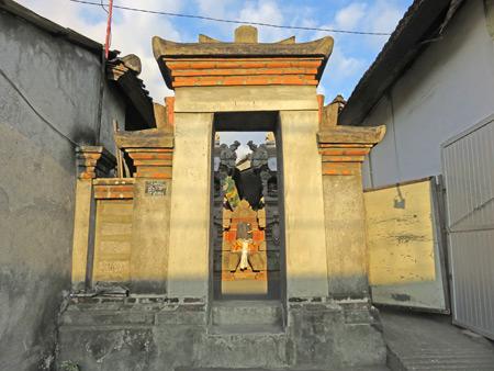 A family compound gate on Jalon Raya Cokorda Gede Rai in Peliatan, Bali, Indonesia.