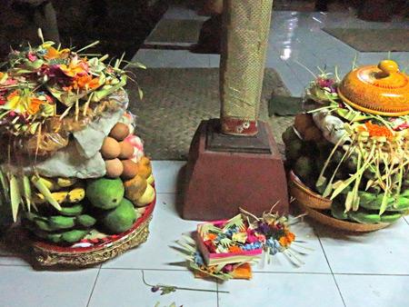 Offerings at a Hindu temple ceremony at Pura Dalem Desa Pakraman Taman Kaja in Ubud, Bali, Indonesia.