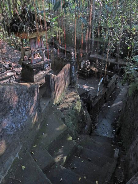 A small Hindu shrine tucked down by a stream in Ubud, Bali, Indonesia.