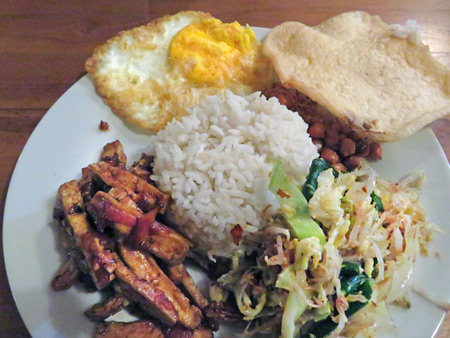Nasi Campur at a guesthouse warung in Ubud, Bali, Indonesia.