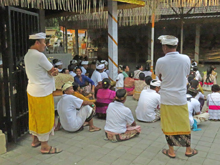 People sit at a small Hindu cremation ceremony in Penestanan, Ubud, Bali, Indonesia.