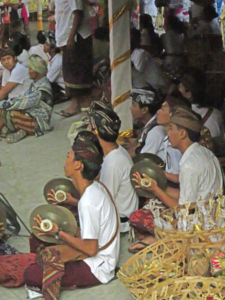 A gamelan plays at a small Hindu cremation ceremony in Penestanan, Ubud, Bali, Indonesia.