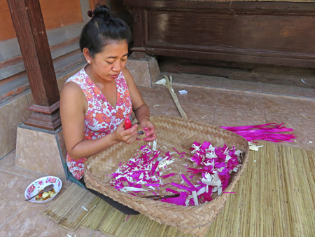 Ketut makes some Hindu offerings at the Arjuna 3 Guesthouse in Ubud, Bali, Indonesia.