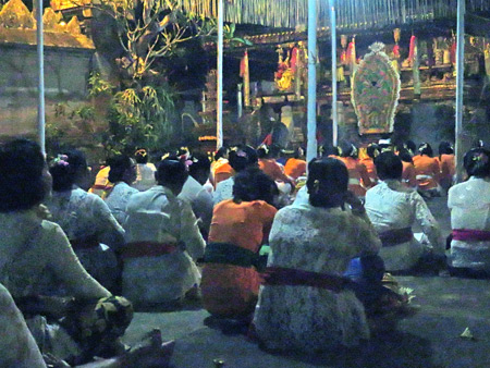 Devotees pray at a Hindu temple ceremony at Pura Penataran Pande in Peliatan, Bali, Indonesia.