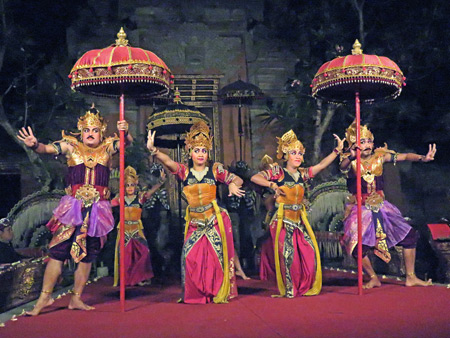 Sekaa Gong Jaya Swara Ubud perform the Tedung Agung dance at Ubud Palace in Ubud, Bali, Indonesia.
