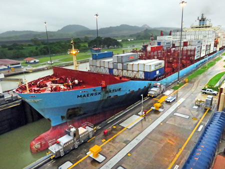 Water is drained from the lock, lowering the Maersk Batur at the Miraflores Locks of the Panama Canal just outside Panama City, Panama.