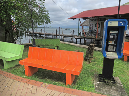 Are these benches bright enough for ya? Do you need a pay phone? Bocas del Toro, Panama.