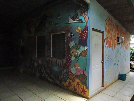 Psychedelic tropical art on the walls at the Bambu Hostel in David, Panama.