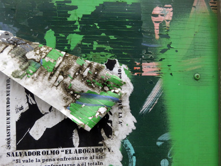 Another mangled flyer on a wall on Central Avenue in San Jose, Costa Rica.