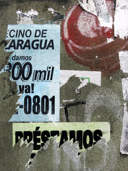 Torn flyers in San Jose, Costa Rica.