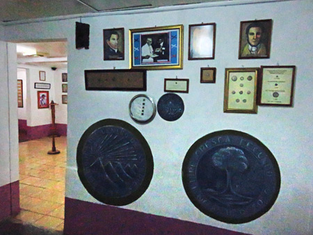 Coins and photos on display at Museo el Ceibo on Isla de Ometepe, Nicaragua.