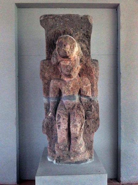 A black-basalt pre-Columbian statue at the Iglesia San Francisco in Granada, Nicaragua.