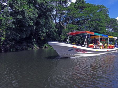 A tourist boat cruises through Las Isletas de Granada, Nicaragua.