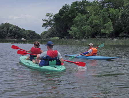 People enjoy kayaking in Las Isletas de Granada, Nicaragua.