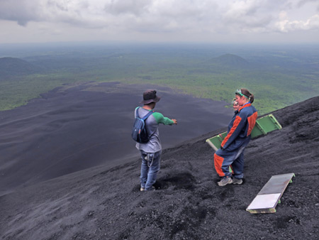 Luis gives some pointers on how to ride the volcano board at the top of Cerro Negro, Nicaragua.