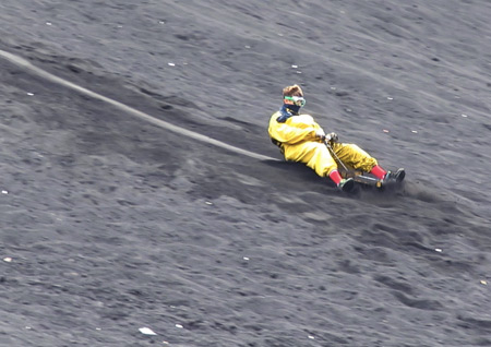 Bob 1, or maybe Bob 2, speeds down the hill at Cerro Negro, Nicaragua.