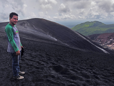 Luis stands at the top of Cerro Negro, Nicaragua.