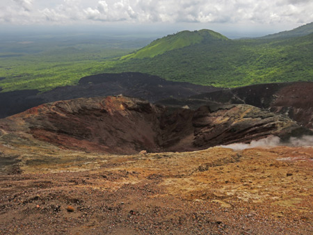 Steam streams from a vent in a crater at the top of Cerro Negro, Nicaragua.