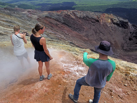 Marius and Whitley stand in a steam vent in a crater at the top of Cerro Negro, Nicaragua.