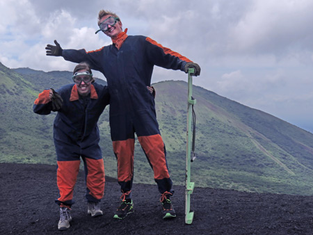 Whitley and Marius mug it up in their funky denim coveralls at the top of Cerro Negro, Nicaragua.