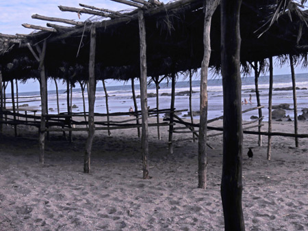 Thatched roof huts in Las Penitas, Nicaragua.