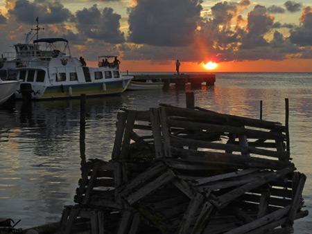 Sunset over a pier in Caye Caulker, Belize.