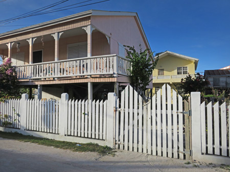 A pastel-colored clapboard house in Caye Caulker, Belize.