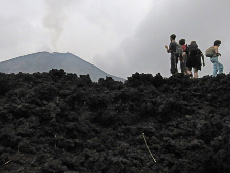 The crew looks out at a nearby cone at Pacaya volcano in Guatemala.