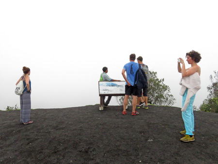 White out conditions at a foggy viewpoint overlooking Pacaya volcano in Guatemala.