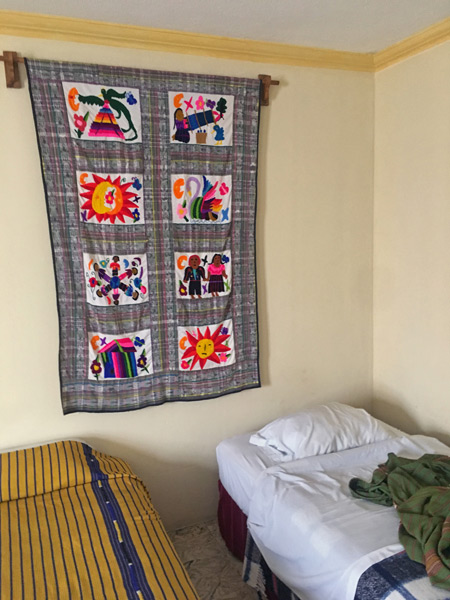 My bed at the Yellow House in Antigua, Guatemala.