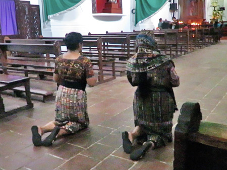 Devotees walk backward on their knees while praying in the Iglesia San Francisco in downtown Panajachel, Lago de Atitlan, Guatemala.