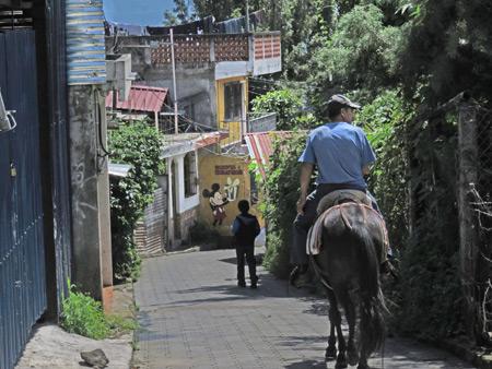 Moises leads the way on a horse ride in San Pedro, Lago de Atitlan, Guatemala.