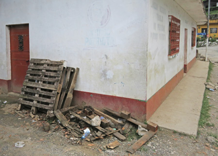 Faded paint and disintegrated pallets in Lanquin, Guatemala.