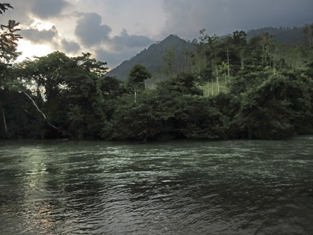 Sunset over the Lanquin river in Lanquin, Guatemala.