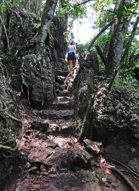 Ascending prehistoric stairs at Semuc Champey, Guatemala.