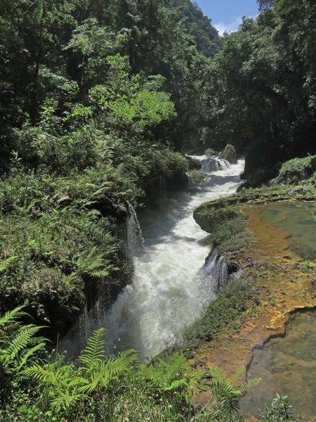 Rushing water entering a cave at Semuc Champey, Guatemala.