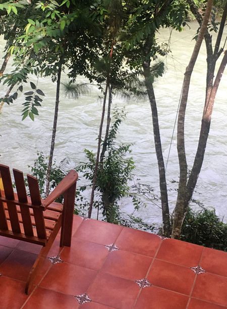 The Hostal Oasis sits right on the banks of the Lanquin river in Lanquin, Guatemala.