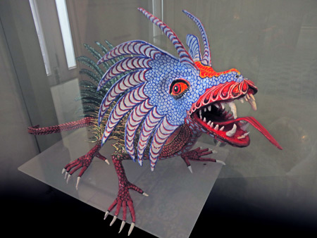 A vividly colored dragon leaps into your face at the Museo de Arte Popular de Yucatan in Merida, Mexico.