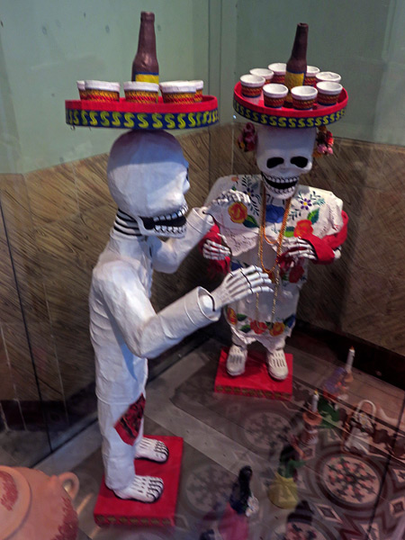 Skeletons brandish brews at the Museo de Arte Popular de Yucatan in Merida, Mexico.